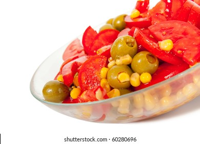 Vegetarian salad on glass plate. Isolated over white