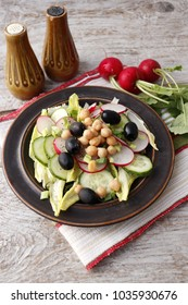 Vegetarian salad from radish with cucumber and chickpeas.