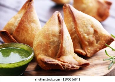 Vegetarian samsa or samosas.Indian special traditional street food punjabi samosa or Coxinha, Croquete and other Fried Brazilian Snacks.