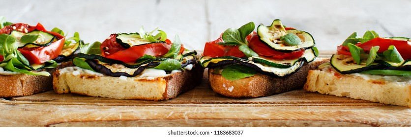 Vegetarian sandwich with fresh cheese, grilled tomatoes, eggplants and zucchini