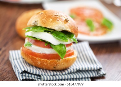 Vegetarian Sandwich with tomatoes, mozzarella and basil.