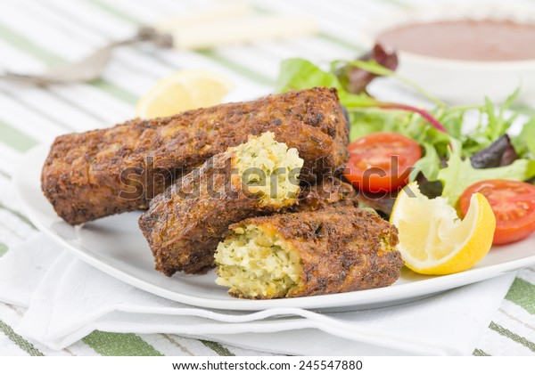 Vegetarian Sausage - Bubble and squeak sausages with salad and chili sauce.