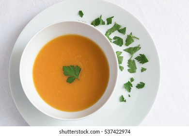 vegetarian soup of potato,carrot, onion, pumpkin, tomato, broccoli is decorated with chopped parsley