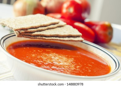Vegetarian soup with tomato, carrot, onion and potato