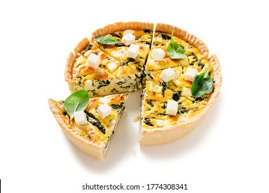 Vegetarian spinach pie or quiche with feta cheese isolated on white background