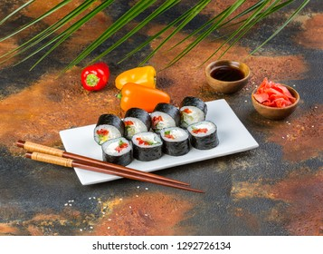 Vegetarian sushi roll set with cucumber, pepper bell and nori