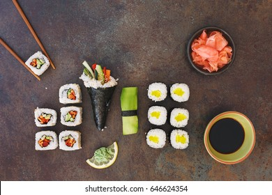 Vegetarian sushi with soy sauce,wasabi  and pickled ginger, served on stone background. Top view, blank space
