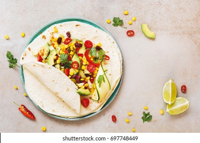 Vegetarian taco wraps. Vegetable tacos with ingredients on rustic surface. Top view, blank space