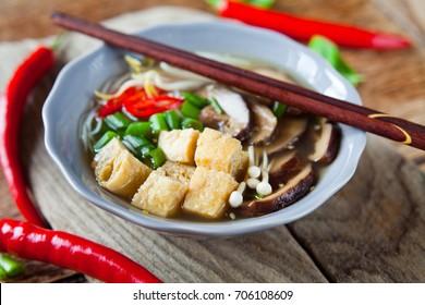 Vegetarian and vegan Asian Cuisine  spicy shiitake mushroom fried tofu rice noodles with vegetables.