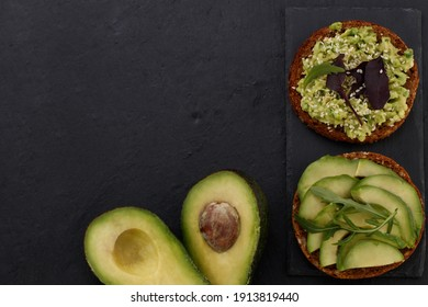 vegetarian or vegan sandwich. Avocado sandwich on dark rye bread on a dark background, top view.