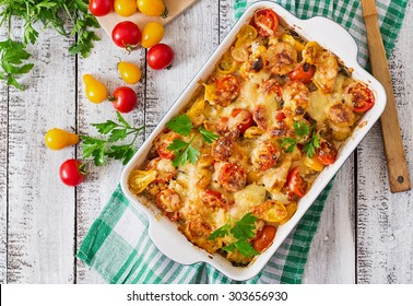 Vegetarian Vegetable casserole with zucchini, mushrooms and cherry tomatoes. Top view