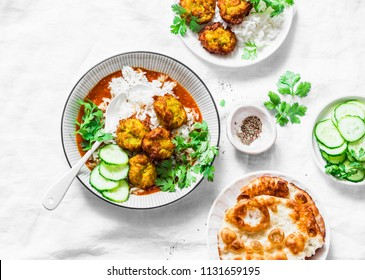 Vegetarian vegetable kofta with rice and curry sauce. Bottle gourd and zucchini fritters. Healthy vegetarian food on light background, top view