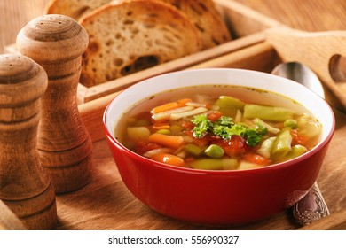 Vegetarian vegetable soup on wooden tray.