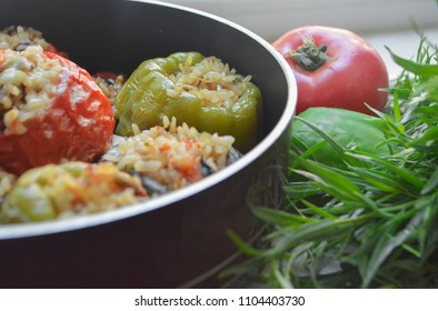 Vegetarian version of traditional Azerbaijani dish three sisters dolma, also called eggplant dolma: fried green bell pepper, tomato and eggplant stuffed with spicy fried rice and greens