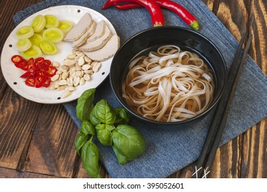Vegetarian vietnamese style soup pho with garnishes and chopsticks. Traditional asian cuisine.