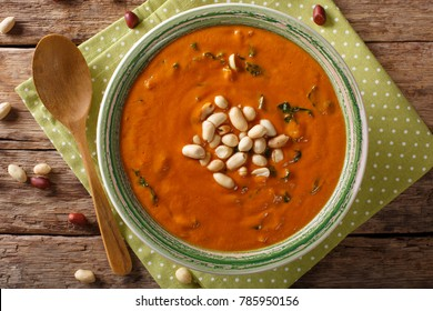 Vegetarian West African Peanut Soup close-up in a plate. on the table. horizontal top view from above