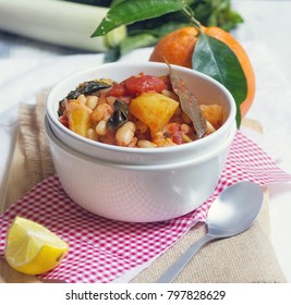 Vegetarian white bean stew with tomatoes, spinach and potatoes