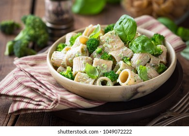 Vegetarian whole grain pasta with creamy broccoli sauce and basil