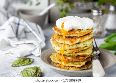 Vegetarian zucchini fritters or pancakes with dill and poached egg