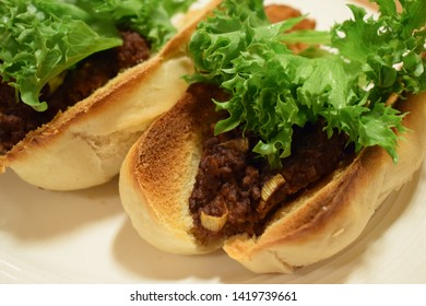 Vegetarian/Vegan Crispy taco/pizza baguettes with tasty and spicy meat substitute, onion, flavor and green lettuce on top close up - mouth watering meal - hungry for food