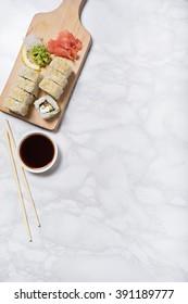 vegetarina sushi served on wooden plate