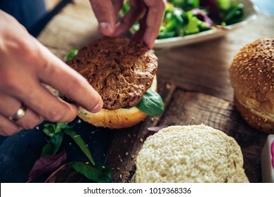 Veggie Burger Being Made On A Wooden Table