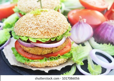 Veggie burger with chickpeas patty, vegan fast food, selective focus