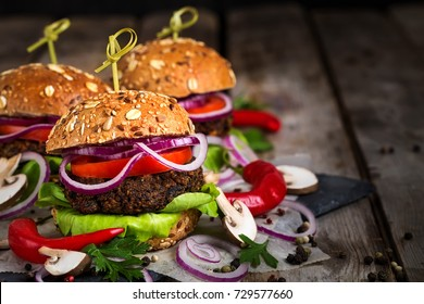 Veggie mushroom and lentil burgers. Copyspace background.