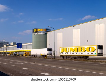 Veghel, Netherlands, February 2018. Distribution center of the Dutch supermarket chain Jumbo, with trucks and logo
