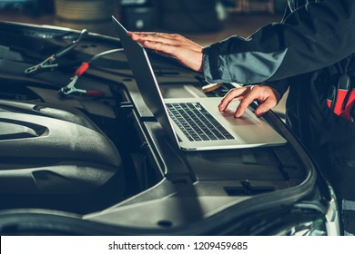 Vehicle Computer Checkup and Engine Software Update by Professional Auto Service Technician. Computerized Automotive Systems.
