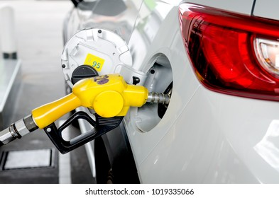 a vehicle fill gasoline in gas station to travel