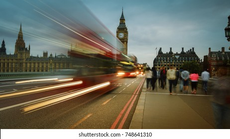 Vehicle and foot traffic near Big Ben in London, UK.