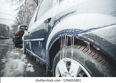 Vehicle in ice. Natural Icy rain. Heavy freezing rain cover on car. Winter Crushed ice. Hoarfrost. Crust of ice after Icy rain. Icy Accumulation. frozen droplets of ice coated car