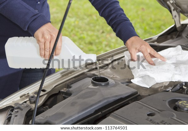 Vehicle maintenance - Filling the windshield washer fluid on a Car