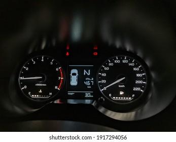 Vehicle meter cluster, up closed and focus on gauge trip meter fuel gauge water temperature gear indicator rpm  speedometer