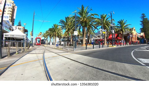 Vehicle POV of intersection of Jetty Road in the seaside suburb of Glenelg. Adelaide, South Australia - January 1, 2019