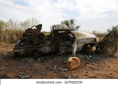 vehicle shot in war in Mali. burnt out vehicle image