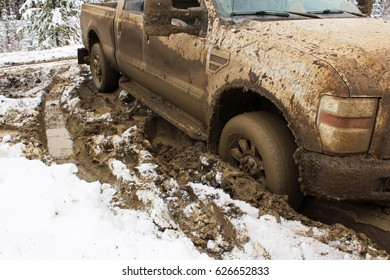 A vehicle stuck in the clay.