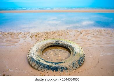 Vehicle tire on the beach