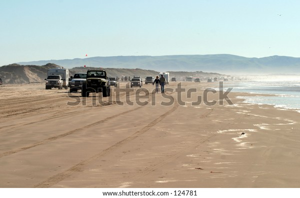Vehicles driving on shore