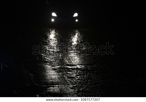 Vehicles running in the rainy wet street at night isolated cars headlamp unique photograph