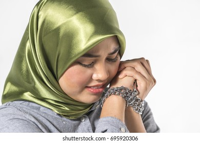 Veiled teenager with expression face. Criminal conceptual.