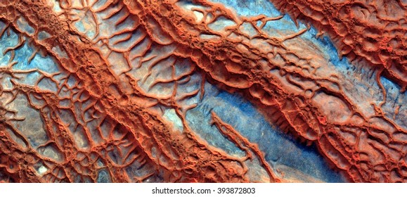 Veins desert, biology imitating nature, red wavy textures,abstract photography of the deserts of Africa from the air, bird's eye view, abstract expressionism, contemporary art, optical illusions,