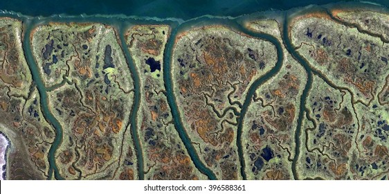 the veins of the marsh, abstract photography of the Spain fields from the air, bird's eye view, tribute to Pollock, artistic representation of human labor camps, abstract expressionism,