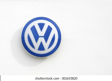 Vejle, Denmark - July 4, 2015: Volkswagen logo on a facade. Volkswagen is a German car manufacturer headquartered in Wolfsburg, Germany