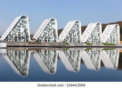 Vejle, Denmark - October 12, 2018: Vejle waterfront in Denmark with wave residential building called bolgen in Danish