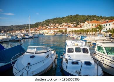 Vela Luka, Croatia - 29.03.2021: Small boats in the port of Vela Luka on old town background, Korcula island, Croatia