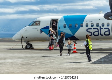 Velas, Azores/Portugal - May 2, 2019: Passenger disembarking from an airplane. Portuguese Azorean airliner SATA airplane landed on the Sao Jorge island airport. Inner island flight.