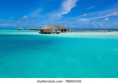 Velassaru Resort in Maldives. A little island resort in the South Male Atoll with exotic beaches, over water sea villas, clear and turquoise water. Velassaru, Maldives - 15 May 2017