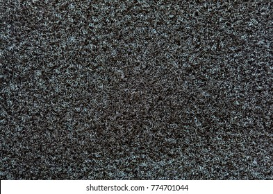 Velcro texture. Black fabric background. Extreme close-up.